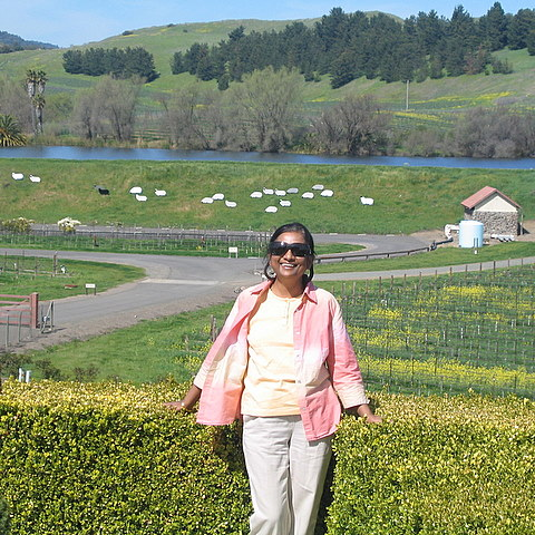 picture of the author on a beautiful summer day in the gardens of a wine estate